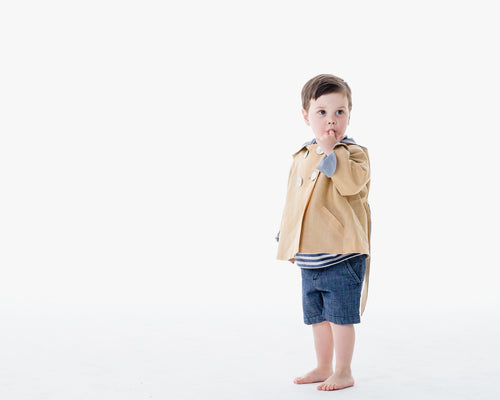 Boy in sky blue linen jacket with bunny ears