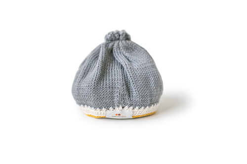 Handmade pima cotton baby hat in stone mustard