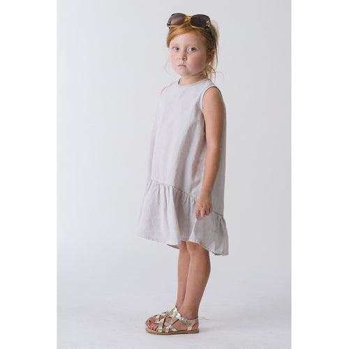 Girl in Organic Sleeveless Ruffle Hem Dress (Pumice)
