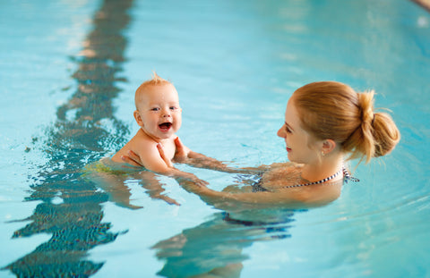 Baby with mom in indoor swimming pool | BlueSmart mia Blog