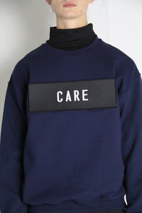Statement sweater // care/don't care