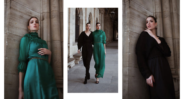 Des and Jen wearing the emerald green maxi dress and the black puffed sleeve maxi dress