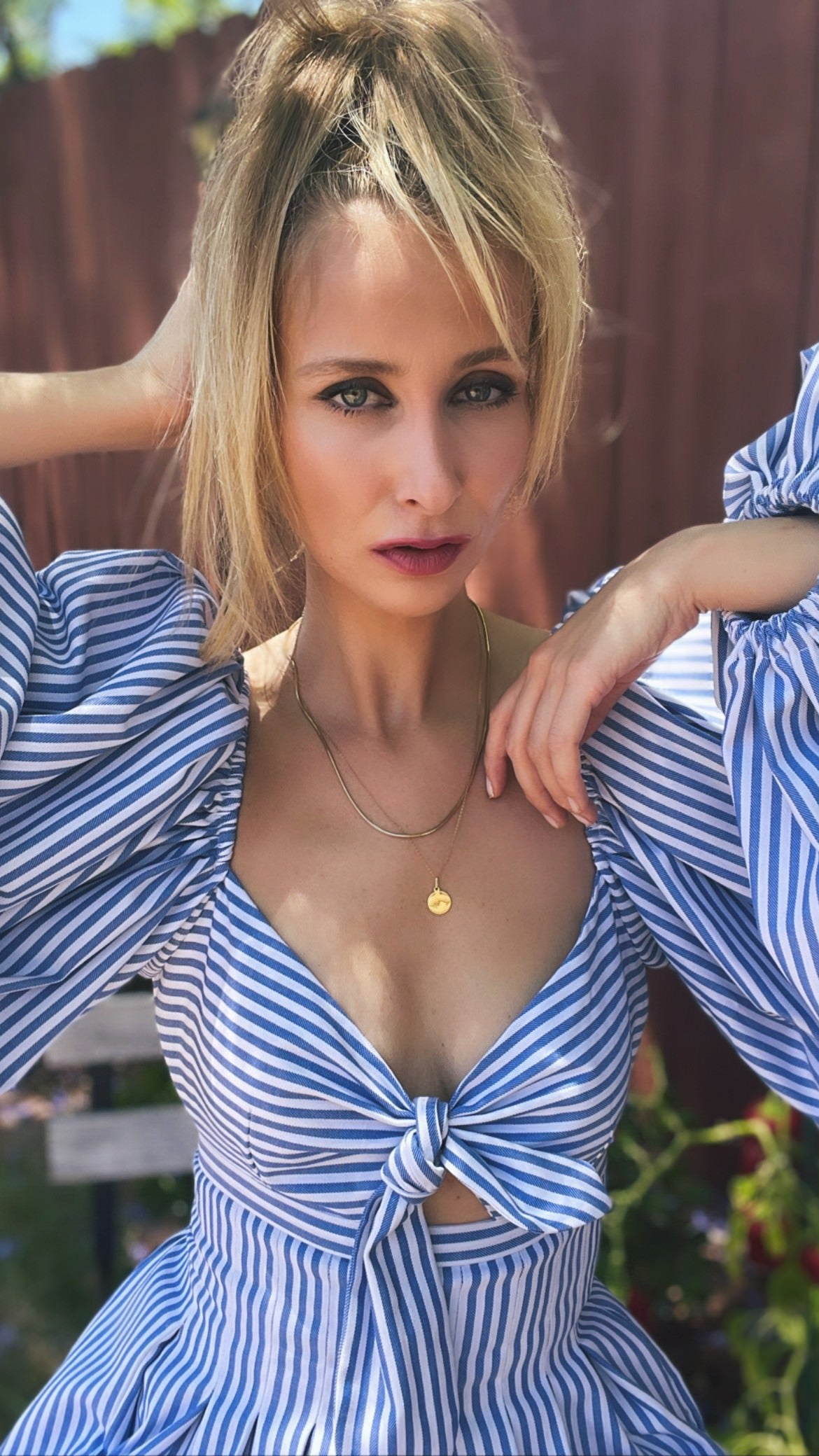 Alina Bock, wearing the Lucia Dress, short stripe dress with puffy sleeves, heart shaped neckline and side pockets
