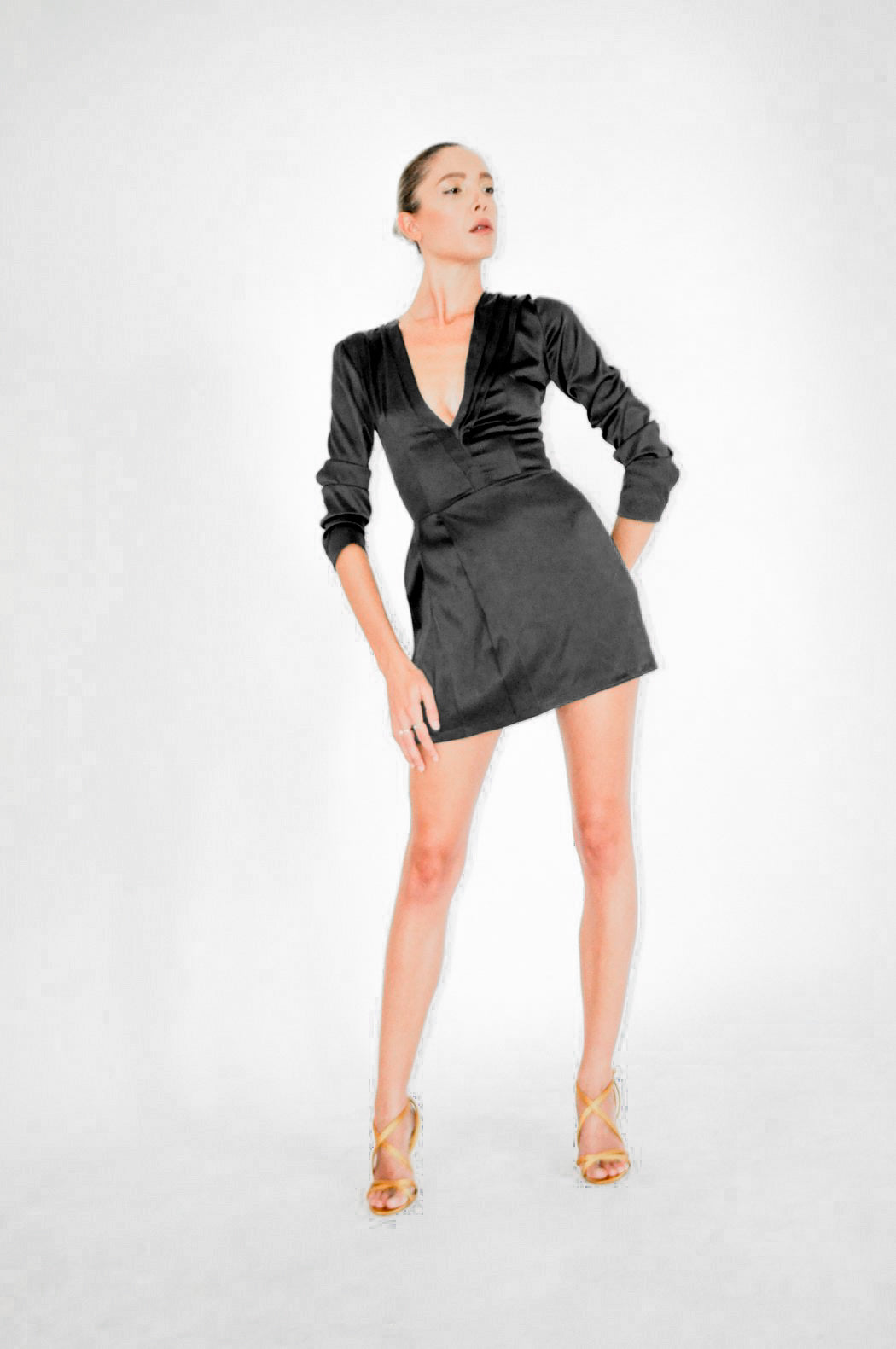 Black plunging neckline dress with long sleeves and side waist pleats