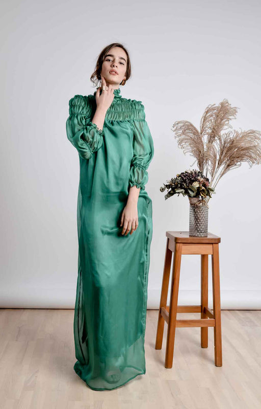 Emerald green turtleneck maxi dress with smocking details