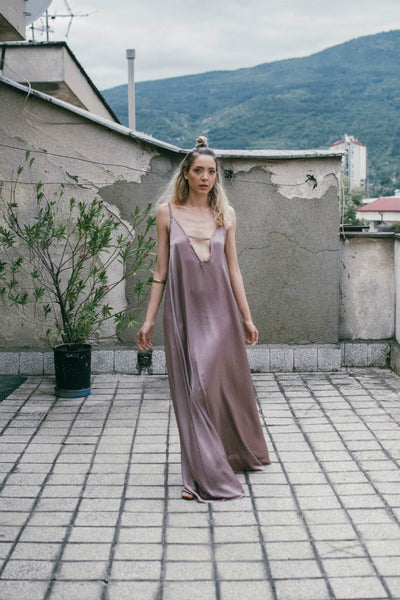 Loose pink silk maxi dress with thin straps and cutout front details