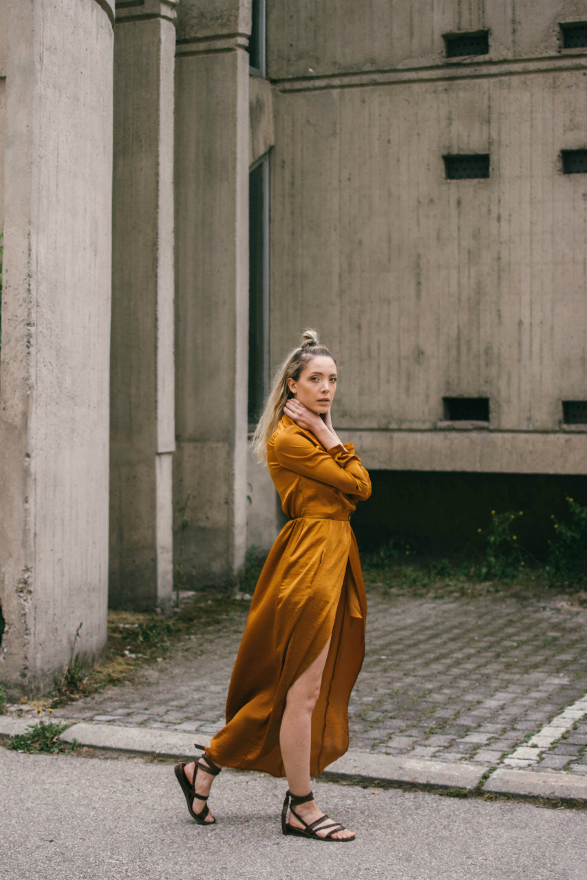 Marigold silky shirt dress with front slit, long sleeves and two front pockets