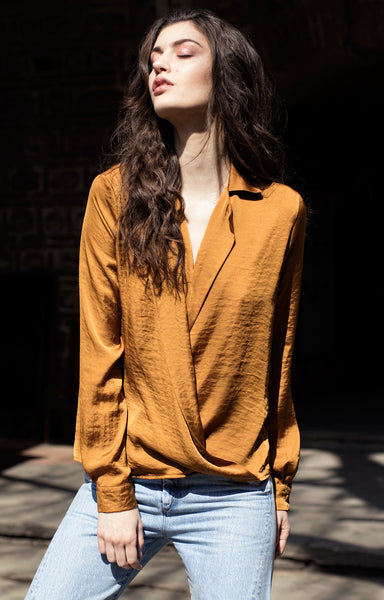 Ocher shirt with plunging neckline and long sleeves