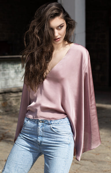 Pink silk shirt with cape sleeves and plunging neckline