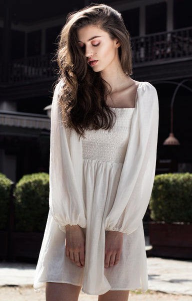 White short dress with bishop sleeves