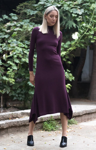 Bastet Noir Bareback knit dress with handkerchief hem, long sleeves and turtleneck