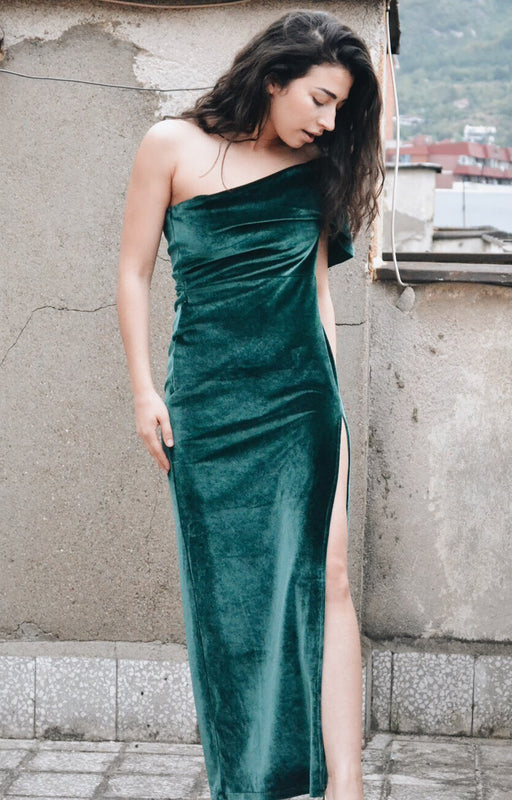 Emerald green velvet maxi dress with side slit