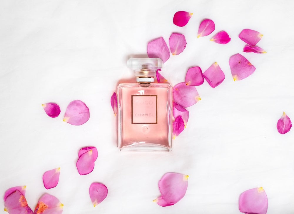 Perfume with rose petals