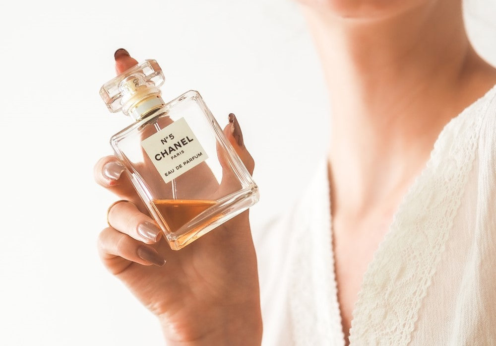 Woman holding a chanel perfume