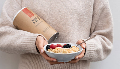 Woman holding a bowl of Muscle Power oatmeal