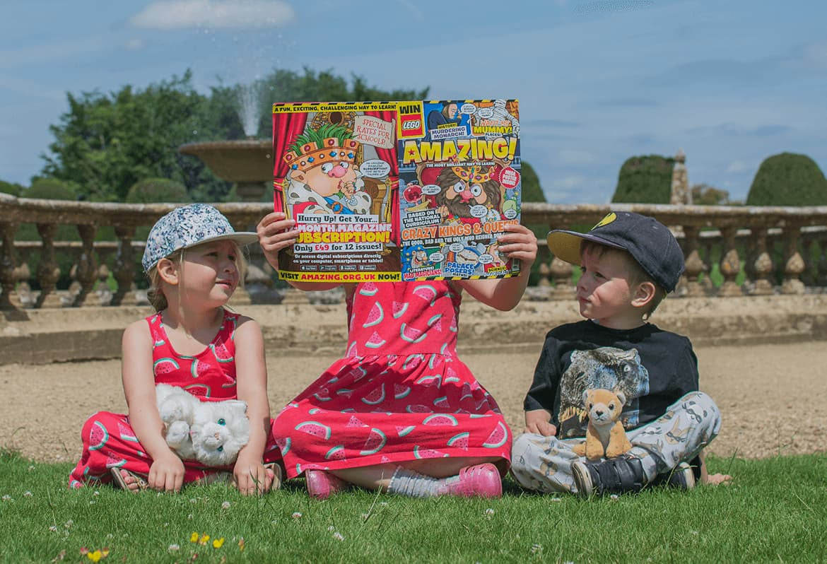children outdoors with amazing magazine