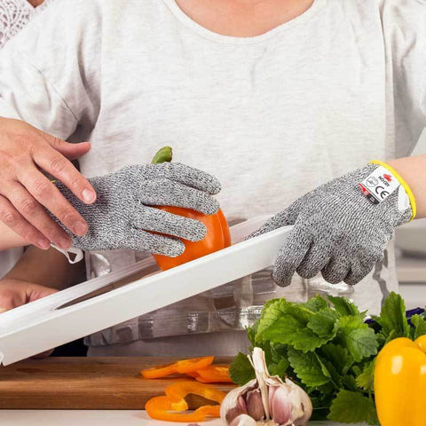 NoCry Cut Resistant Gloves For Kids slicing tomatoes with mandoline
