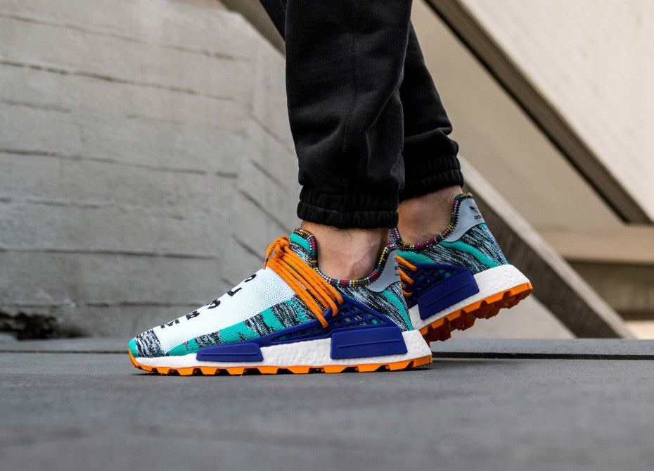 on sale 76ca3 f4bf7 Pharrell x Adidas NMD Human Race Trail Solar Pack