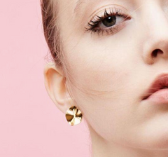 Biko gold earrings from Shop Innermuse