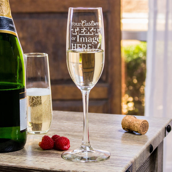 Personalized Champagne Flutes. Customize your engraved champagne glass with a monogram, logo, or unique text.