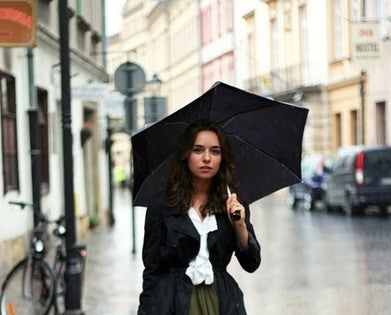 Young woman under an umbrella