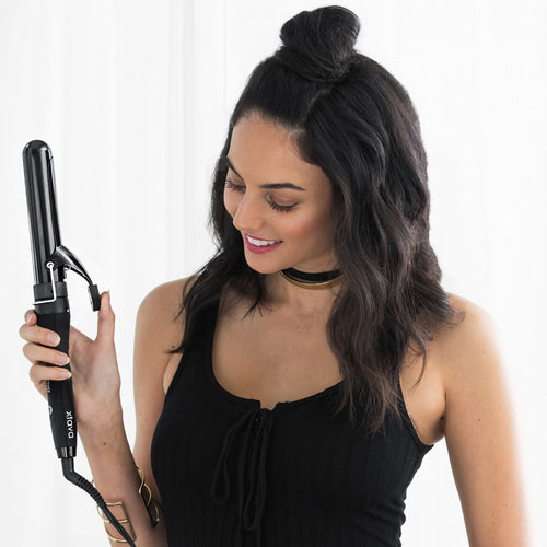 woman with xtava curling iron