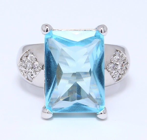 aquamarine-cubic-zircon-ring-emerald-cut-prong-set-in-white-gold-plating