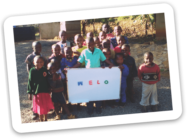 photo of children holding a Welo sign