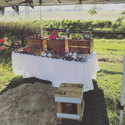 market stall table with avarcas layed out