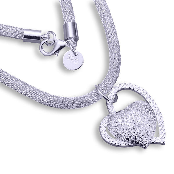 Plated Silver  diamante Heart Necklace.