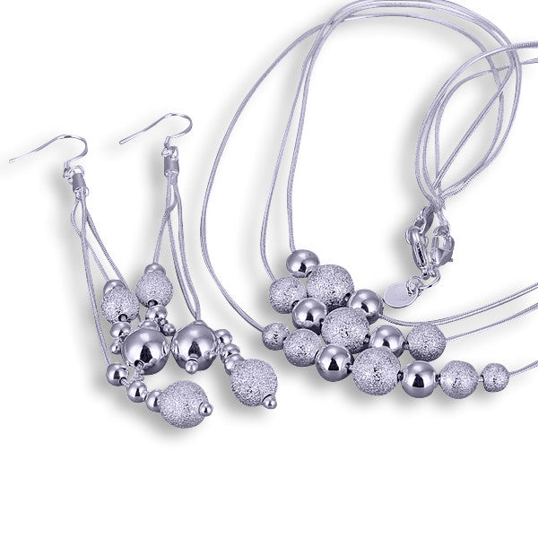 Plated Silver 3 Strand Bead Necklace and Earrings set.