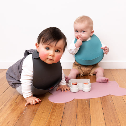 We Might Be Tiny silicone bibs in Blue dusk and Charcoal