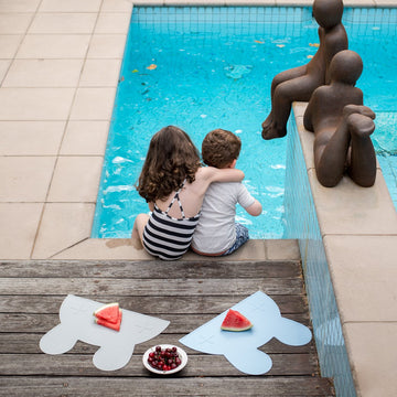 We Might Be Tiny bunny placemats by the pool