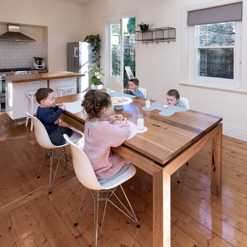 Table of children with We Might Be Tiny placemats
