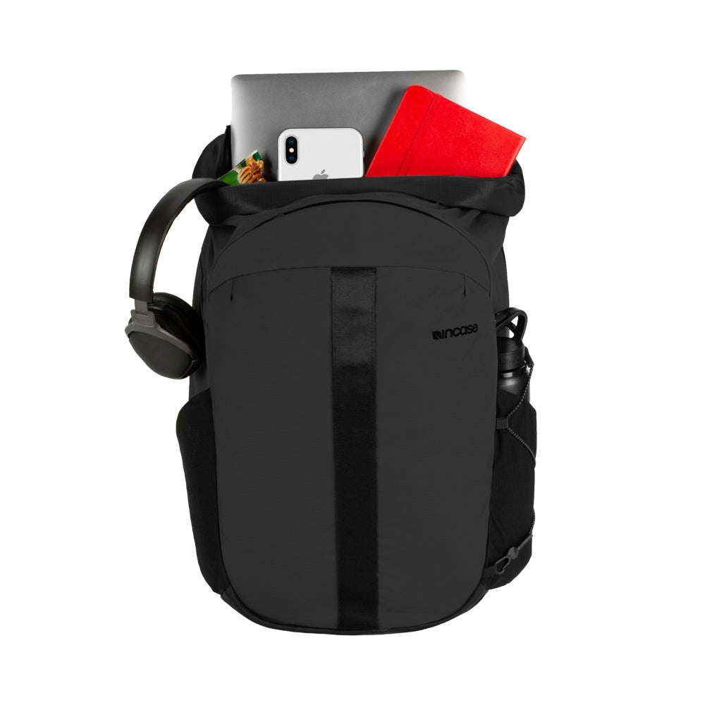 Black Nylon Ripstop with mesh side pockets, Computer slot and small compartments inside