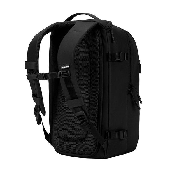 Black DSLR pro camera bag with tri pod holster and chest strap
