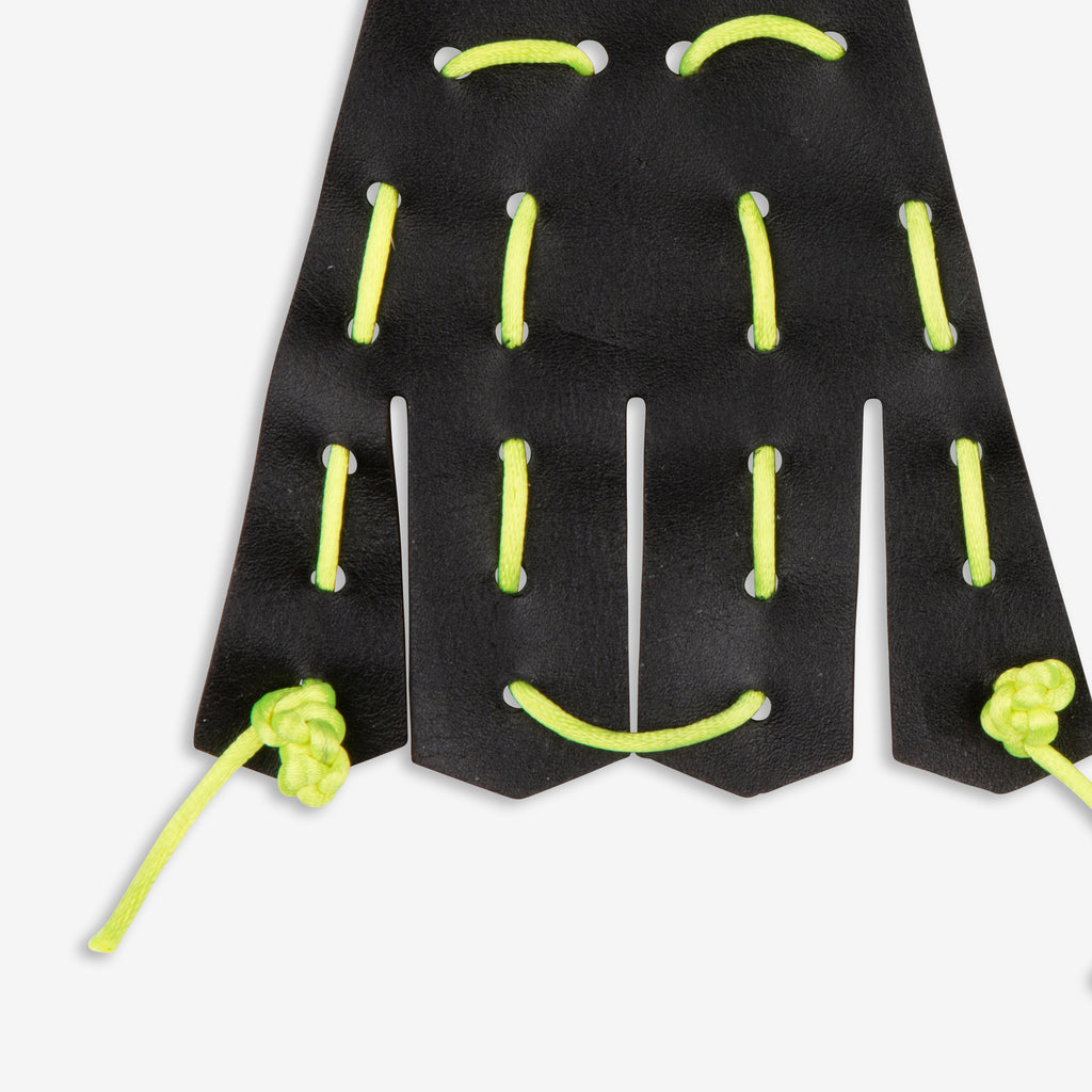 Black leather kilties with neon yellow cord whipstitch