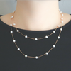 White stars gold necklace