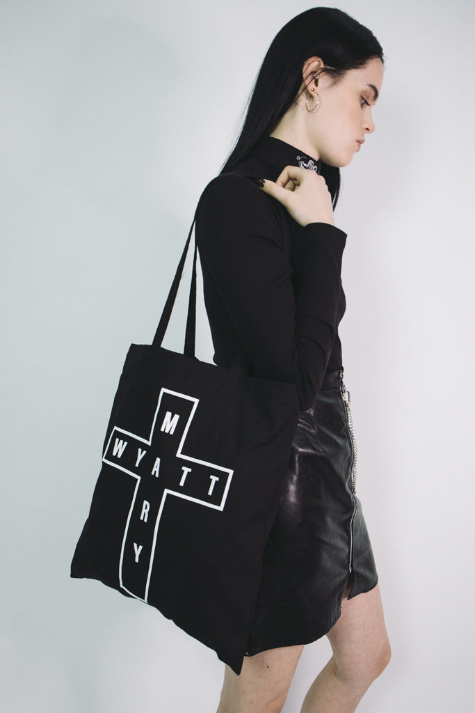 black tote bag with mary wyatt cross