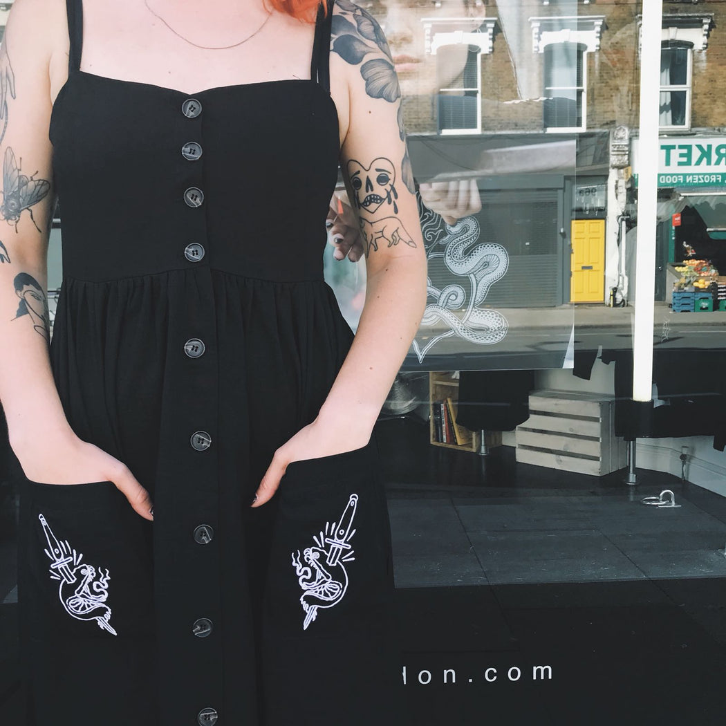 mary wyatt london black button up sun dress with snake head embroidery on pockets