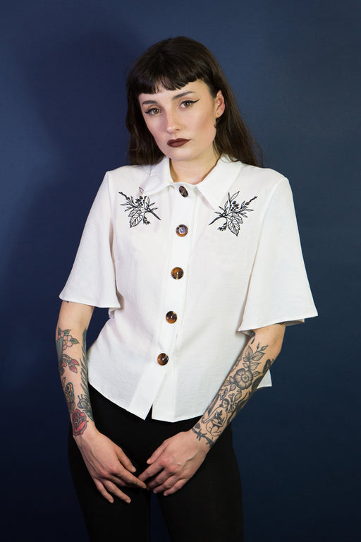 Mary Wyatt London white button up short sleeved shirt with embroidered florals by Rebecca Vincent Tattoo