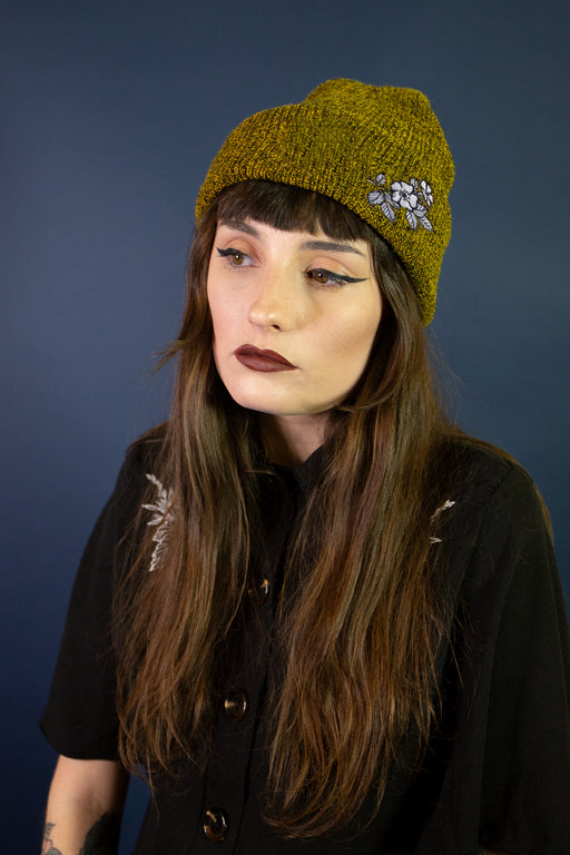 Mary Wyatt London beanie with flower illustration embroidery by Rebecca Vincent Tattoo