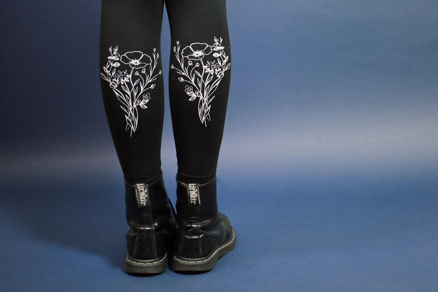 Black leggings with poppy illustration on calf from Rebecca Vincent collaboration with Mary Wyatt London