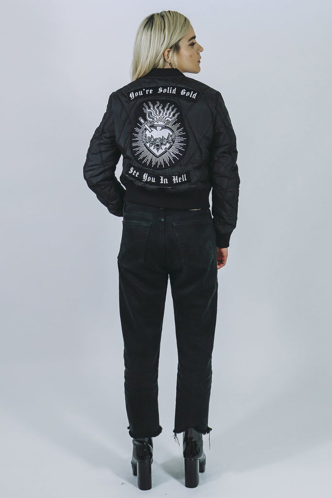 "bomber jacket black mary wyatt black quilted cropped bomber jacket with embroidered back patch with sacred heart and ""you're solid gold, see you in hell"""