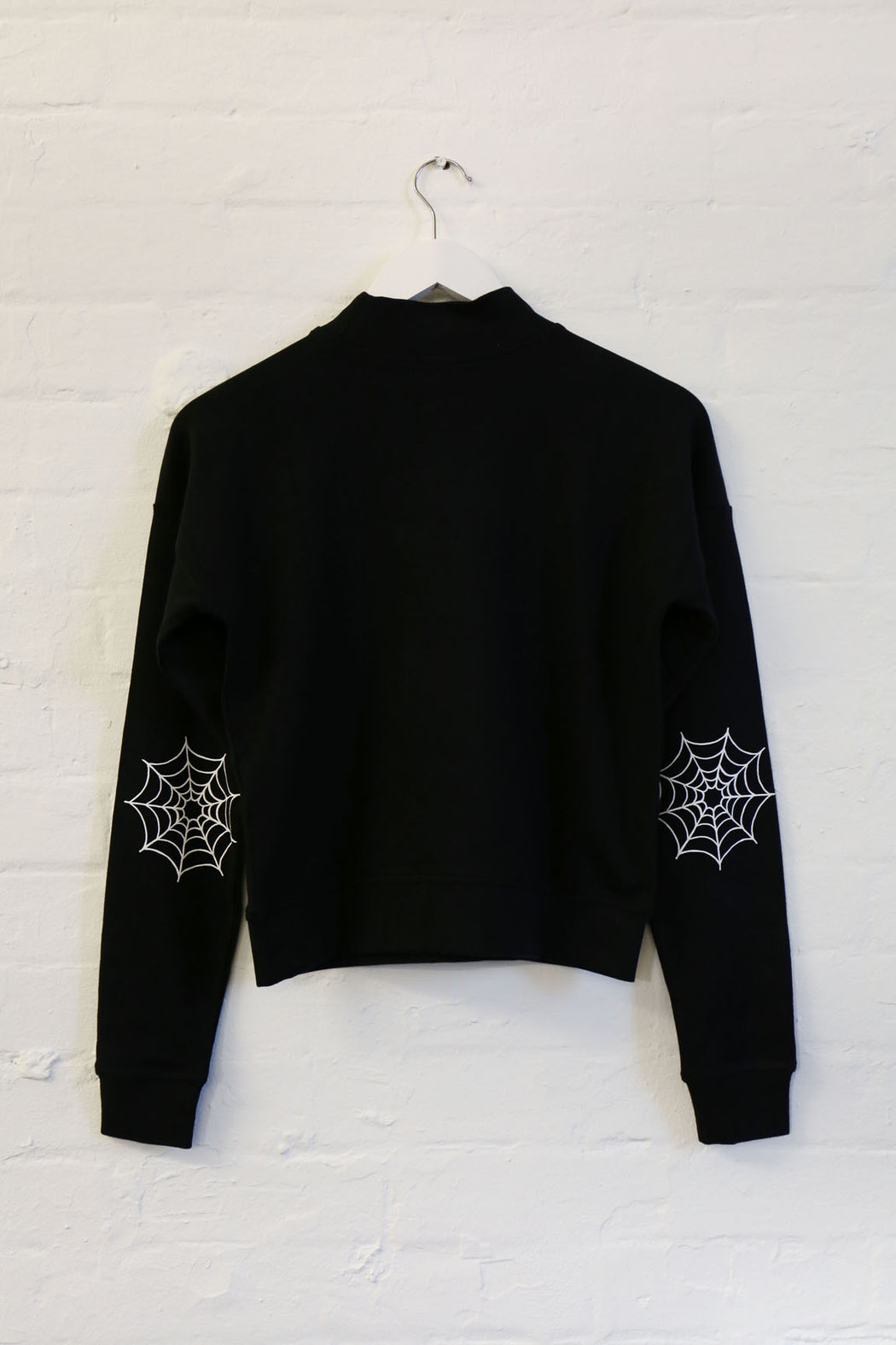 mary wyatt london black jumper with high neck and spider web screen printed on elbows alternative womens fashion