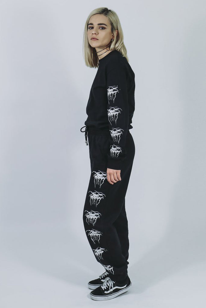 mary wyatt london black tracksuit bottoms with MW Throne logo repeated down one side