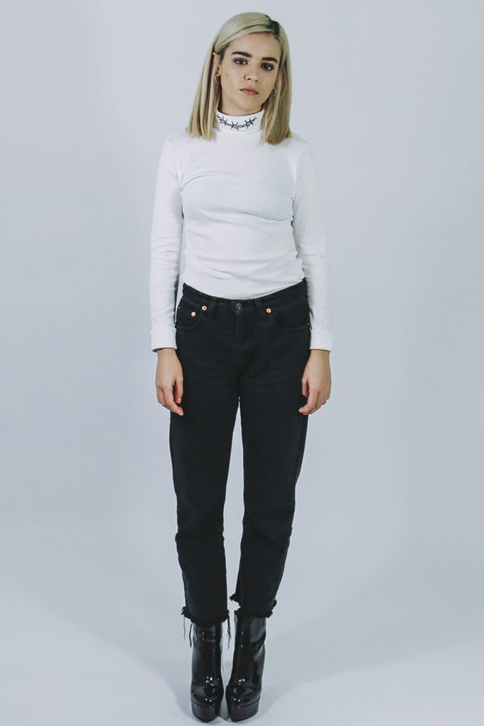mary wyatt london white roll neck top with barbed wire embroidered on neck