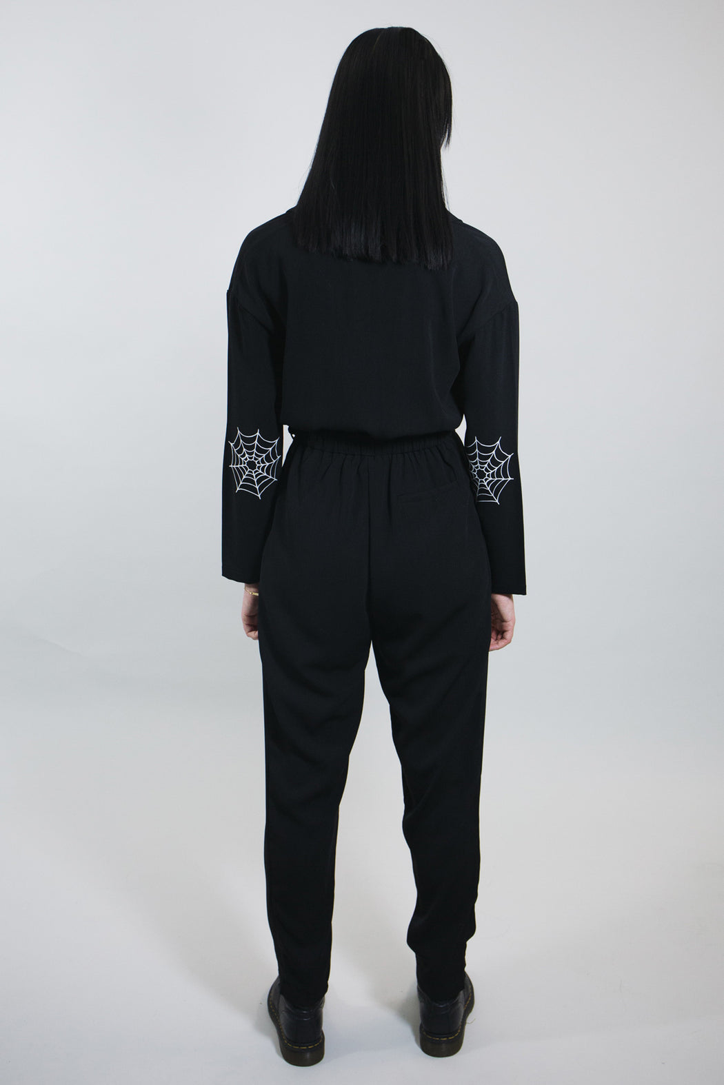 mary wyatt london black jumpsuit with spider web printed on elbow and belt alternative goth womens fashion