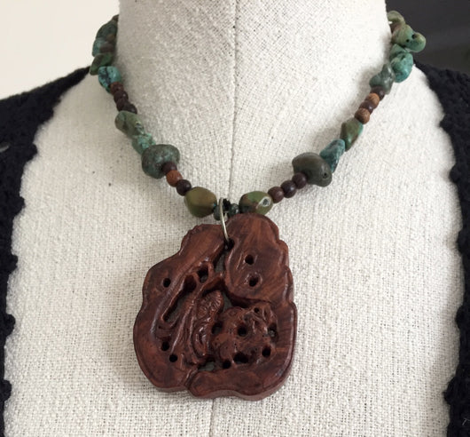 Hand-carved wooden Buddha pendant + turquoise + wood necklace