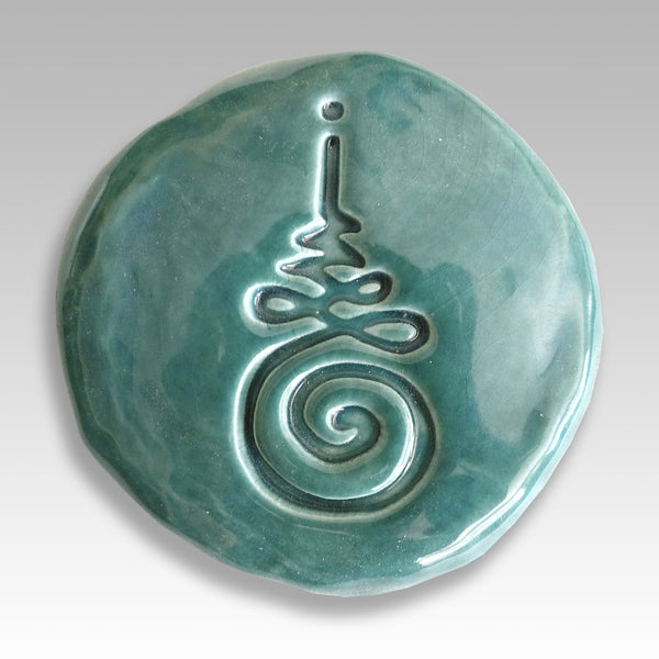 Male ceramic Buddhist Unalome symbol for enlightenment